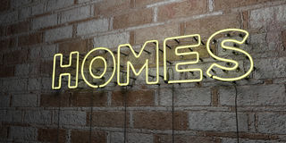 HOMES - Glowing Neon Sign on stonework wall - 3D rendered royalty free stock illustration Stock Photos