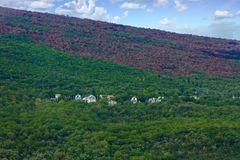 Homes on Green Hill Near Fire Line Royalty Free Stock Photos