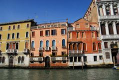 Homes and historic palace on the Grand Canal in Venice in Italy Royalty Free Stock Images