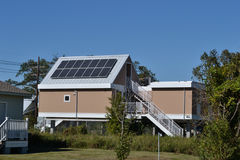 Homes Housing  Home with Solar Panels. Modern Elevated Home with Solar Energy Panels Royalty Free Stock Photos