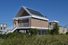 Homes Housing  House with Solar Panels. Modern Elevated Home with Solar Energy Panels Stock Photos