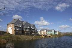 Homes  by the lake. A new development of wooden houses by a lake Stock Photo
