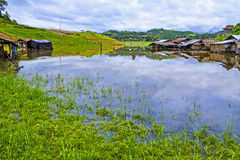 Homes on lake after rains Royalty Free Stock Photos
