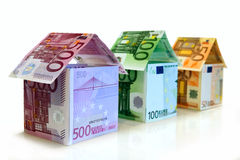 Homes made with euro. Three homes constructed from Euro paper currency Stock Photos