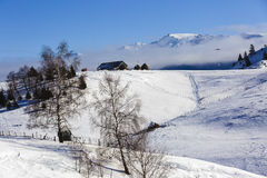 Homes in the mountains. In winter landscape Stock Image