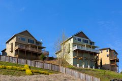 Homes on Stilts along Hillside Lots Royalty Free Stock Images
