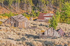 Homes, Outhouse, and School Royalty Free Stock Photos