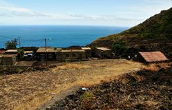 Homes by the road and sea in Fogo, Cabo Verde Royalty Free Stock Image