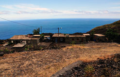 Homes by the road and sea in Fogo, Cabo Verde Royalty Free Stock Photo