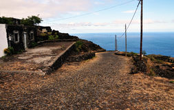 Homes by the road and sea in Fogo, Cabo Verde Royalty Free Stock Photos