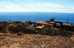 Homes by the road and sea in Fogo, Cabo Verde Royalty Free Stock Images