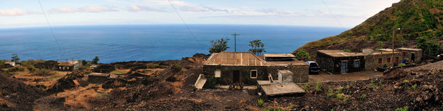 Homes by the road and sea in Fogo, Cabo Verde Stock Photos
