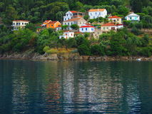 Homes on shore of Ionian Sea. Royalty Free Stock Images