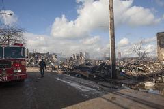 Homes sit smoldering after Hurricane. NEW YORK - October 31: Homes sit smoldering after Hurricane Sandy  in the Far Rockaway area . Over 50 homes were reportedly Royalty Free Stock Photo