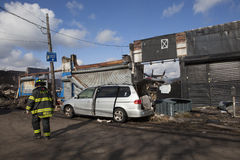 Homes sit smoldering after Hurricane. NEW YORK - October 31: Homes sit smoldering after Hurricane Sandy  in the Far Rockaway area . Over 50 homes were reportedly Royalty Free Stock Images