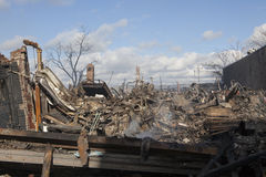 Homes sit smoldering after Hurricane. NEW YORK - October 31: Homes sit smoldering after Hurricane Sandy  in the Far Rockaway area . Over 50 homes were reportedly Royalty Free Stock Photography
