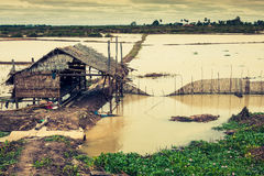Homes on stilts on the floating village of Kampong Phluk, Tonle Royalty Free Stock Photography