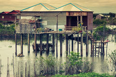 Homes on stilts on the floating village of Kampong Phluk, Tonle Royalty Free Stock Image