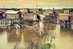 Homes on stilts on the floating village of Kampong Phluk, Tonle Stock Photos