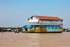 Homes on stilts on the floating village of Kampong Phluk, Tonle Sap lake, Siem Reap province, Cambodia Royalty Free Stock Image