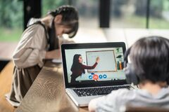 Free Homeschool Asian Little Young Boy Learning Online Class From School Teacher By Digital Remote Internet Meeting Due To Coronavirus Stock Image - 209830051