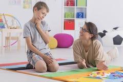 Homeschooling seu filho Imagens de Stock
