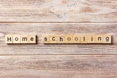 Homeschooling word written on wood block. Home schooling text on table, concept.  Stock Photo