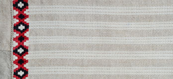 Homespun fabric with white stripes and embroidery Stock Photo