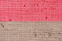Homespun striped carpet. Background Royalty Free Stock Images