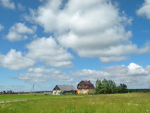 Homestead in field Stock Photography