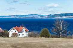 Homestead on the large lake shore Royalty Free Stock Photography