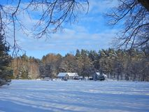 Homestead near forest in winter, Lithuania stock photography
