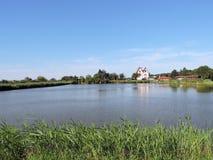 Homestead near pond Stock Image