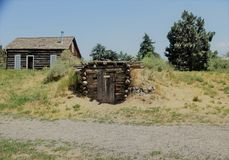 Homestead. An old homestead with a root cellar and cabin Stock Image