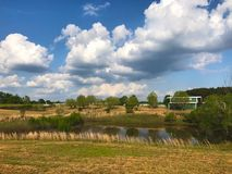 Homestead. Open meadow pasture and pond on a homestead royalty free stock images