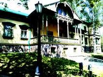 Homestead. Polish Manor Pan in the park Stock Photos