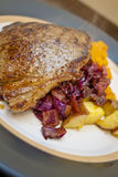 Homestyle Steak Dinner. A homestyle steak dinner with braised red cabbage potatoes and sweet squash Royalty Free Stock Photography