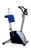 Hometrainer. Home-trainer for workout, isolated on white background, reflective surface Stock Image