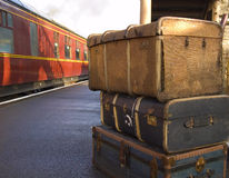 Homeward Bound. Old Steam train in station with luggage stock photography