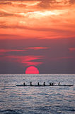 Homeward Bound. Hawaiian women paddling a canoe home at sunset royalty free stock photo