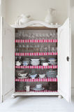Homeware In Open Storage Cupboard Royalty Free Stock Images