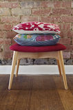 Homewares cushions on ottoman stool Stock Image