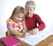 Homework. Mother and daughter doing homework Royalty Free Stock Image