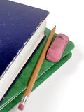 Homework. A green notebook, a blue textbook, a pencil and an eraser Royalty Free Stock Photography