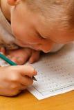 Homework. Grade one student doing worksheet / homework at home Stock Photo