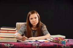 Homework. Young girl doing her homework Stock Photo