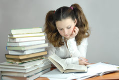 Homework. Student's lessons, tries to read, learn, education receives Royalty Free Stock Photos