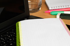 Homework. Focus on the edge of the notebook. Shallow depth of field Stock Photography