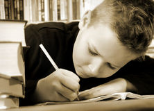 Homework. Young boy does his homework stock images