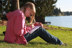 Homework. 13 year old girl doing her home work royalty free stock photos